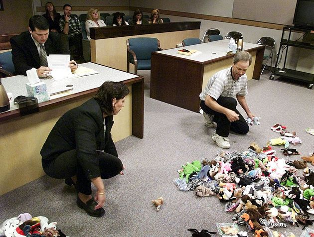 Divorving couple splitting beanie babies