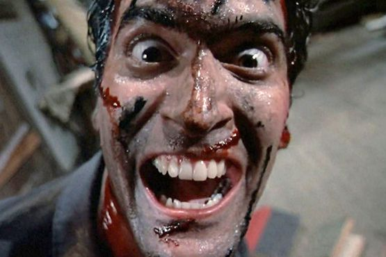 "Bruce Campbell as Ashley ""Ash"" Williams in 'Evil Dead II'"